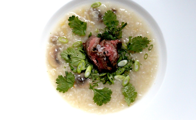 Congee with herbs and sliced steak