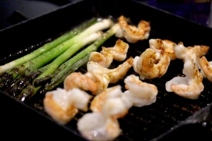 prawns and spring onions frying