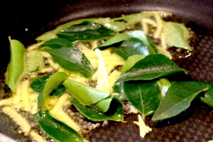 curry leaves ginger and mustard seeds in oil