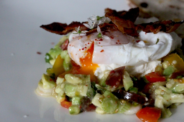 poached egg on avocado salsa with whipped feta and pancetta