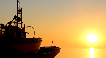 Fishing boats and sunrise