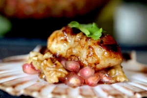 salted rice malt marinated skate cheeks with walnut and pomegranate salsa