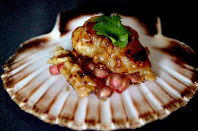Salted rice malt marinated skate cheek with walnut and pomegranate salsa