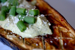 Roast aubergine with hummus and French beans