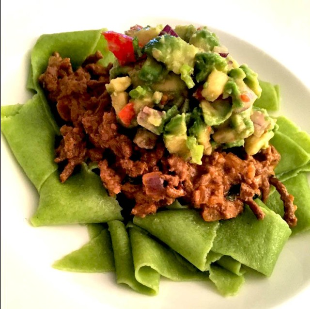 watercress pasta with beef ragu and avocado salsa