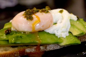 poached egg and avocado sandwich with raw hot sauce