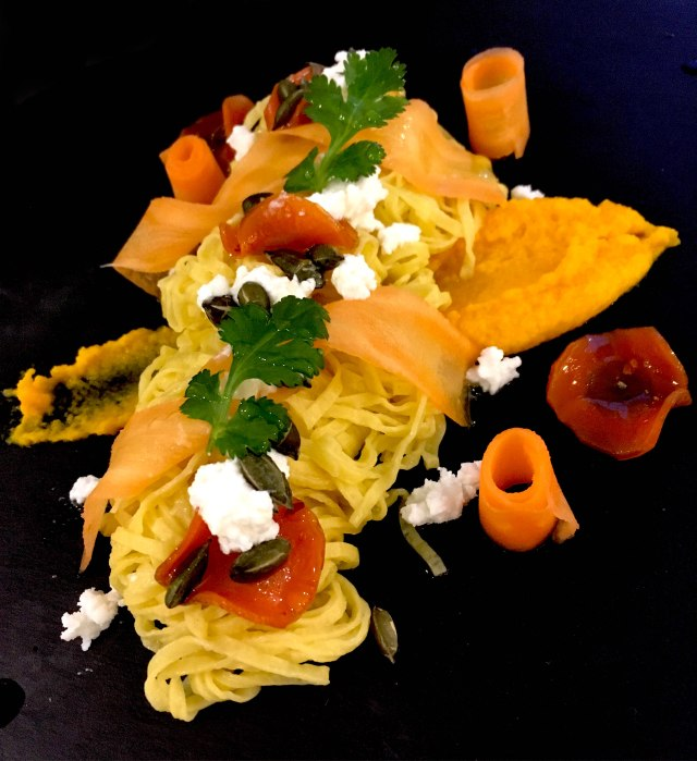 Carrot three ways with carrot pasta, goats cheese, pumpkin seeds