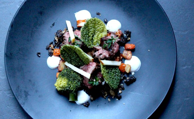 Steak with beef jam, black pudding crumble and savoy cabbage