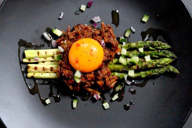 pulled pork ragu asparagus and egg yolk