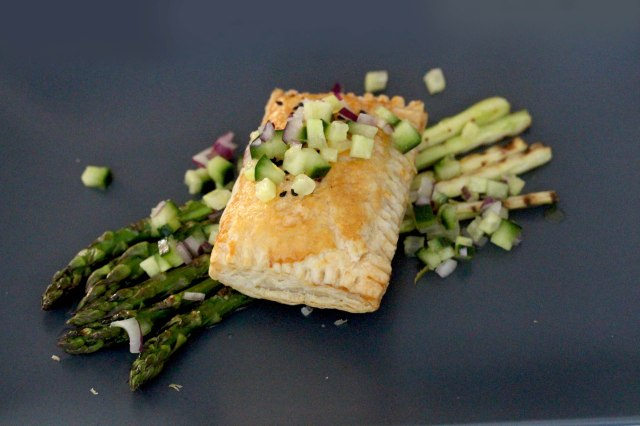pulled pork ragu puff pastry on asparagus