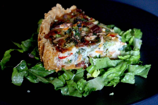 Vegetable and bacon quiche with salad