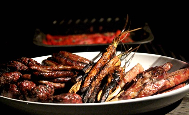 barbecue meat and root vegetables