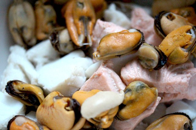 poached fish and mussels