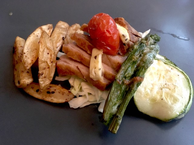 Duck with oven fries and baked vegetables