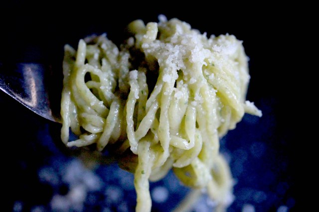 Grated Parmesan cheese and wild rocket spaghetti
