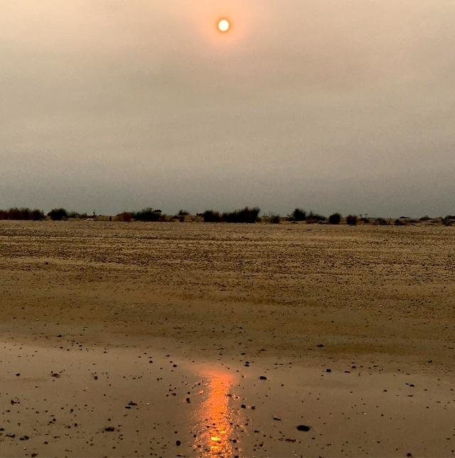 Red Sun on the beach