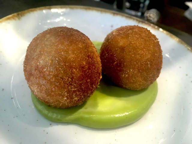 Oxtail croquettes with pea and wasabi puree