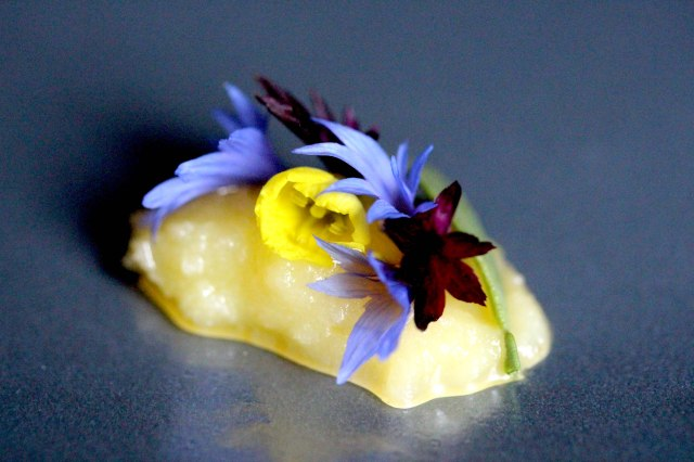 truffle butter and edible flowers in a clear edible disc